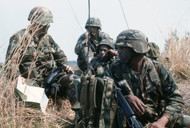 Members of the 82nd Airborne Division establish radio contact with other ground forces during Exercise SOLID SHIELD'87