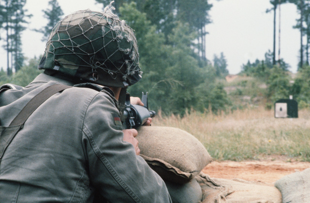 STAFF Sergeant (SSGT) K.H. Buender of the German security police team aims an M16A1 rifle at a pop-up target on the combat marksmanship course during the ninth international airlift competition Airlift Rodeo'87