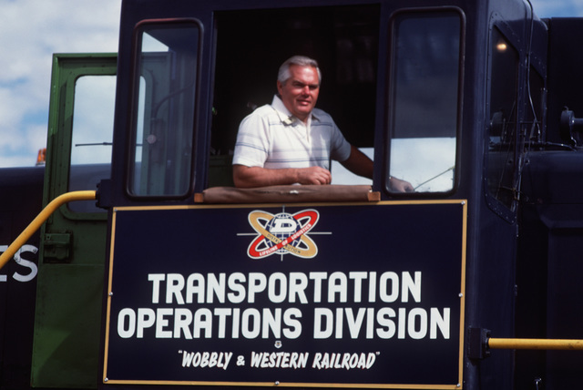 Train engineer Jerry Dole of the McClellan AFB Transportation Operations Division stands by at the controls of a diesel locomotive
