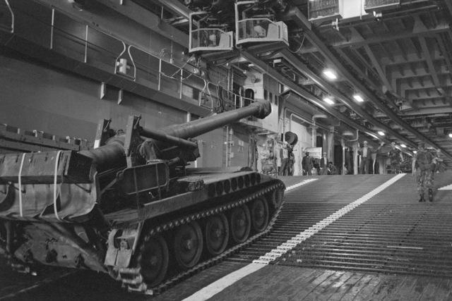 An M110A2 203 mm self-propelled Howitzer moves up a ramp into the well deck of the amphibious transport dock USS TRENTON (LPD 14) during the field training Exercise SOLID SHIELD'87