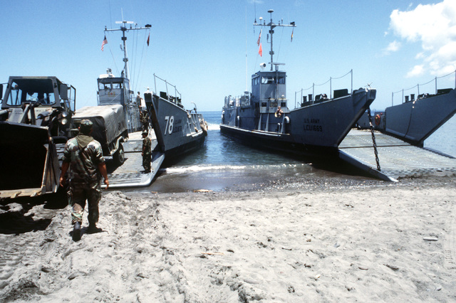 A Case W24C loader is offloaded from the US Army utility landing craft LCU 1678 in support of the 92nd Infantry Brigade, Puerto Rico National Guard, during Exercise CAMILLE.  US Army utility landing craft LCU 1669 is on the right