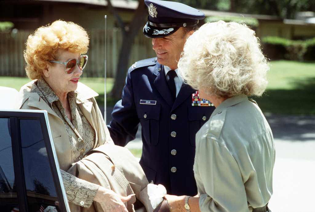COL Marvin S. Ervin, commander, 63rd Military Airlift Wing, and his wife Jenny greet entertainer Lucille Ball who will be performing in the Bob Hope birthday special show during the opening of Airlift Rodeo '87 at Pope Air Force Base, N.C