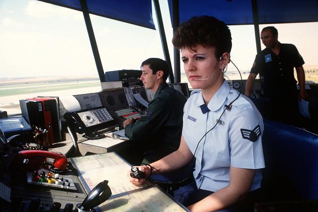 Senior AIRMAN Deborah Behrle and Staff Sgt. Joe English work as air traffic controllers