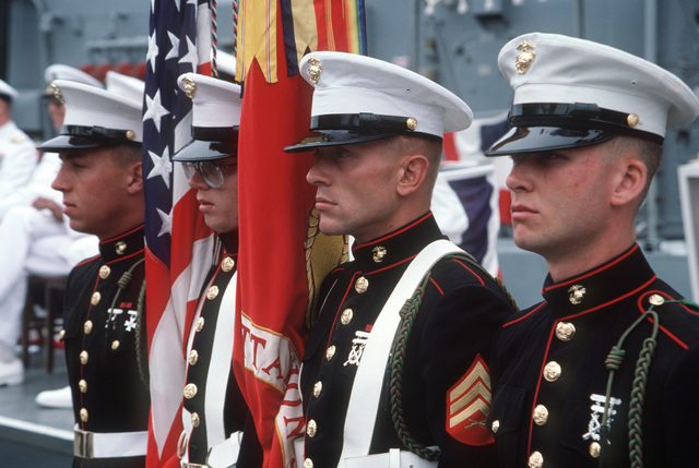 A Marine Corps color guard stands at attention during the commissioning of the guided missile frigate USS RODNEY M. DAVIS (FFG 60)