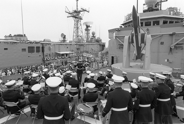 Members of the US Marine Corps Band, Camp Pendleton, California, perform during the commissioning of the guided missile frigate USS RODNEY M. DAVIS (FFG 60)