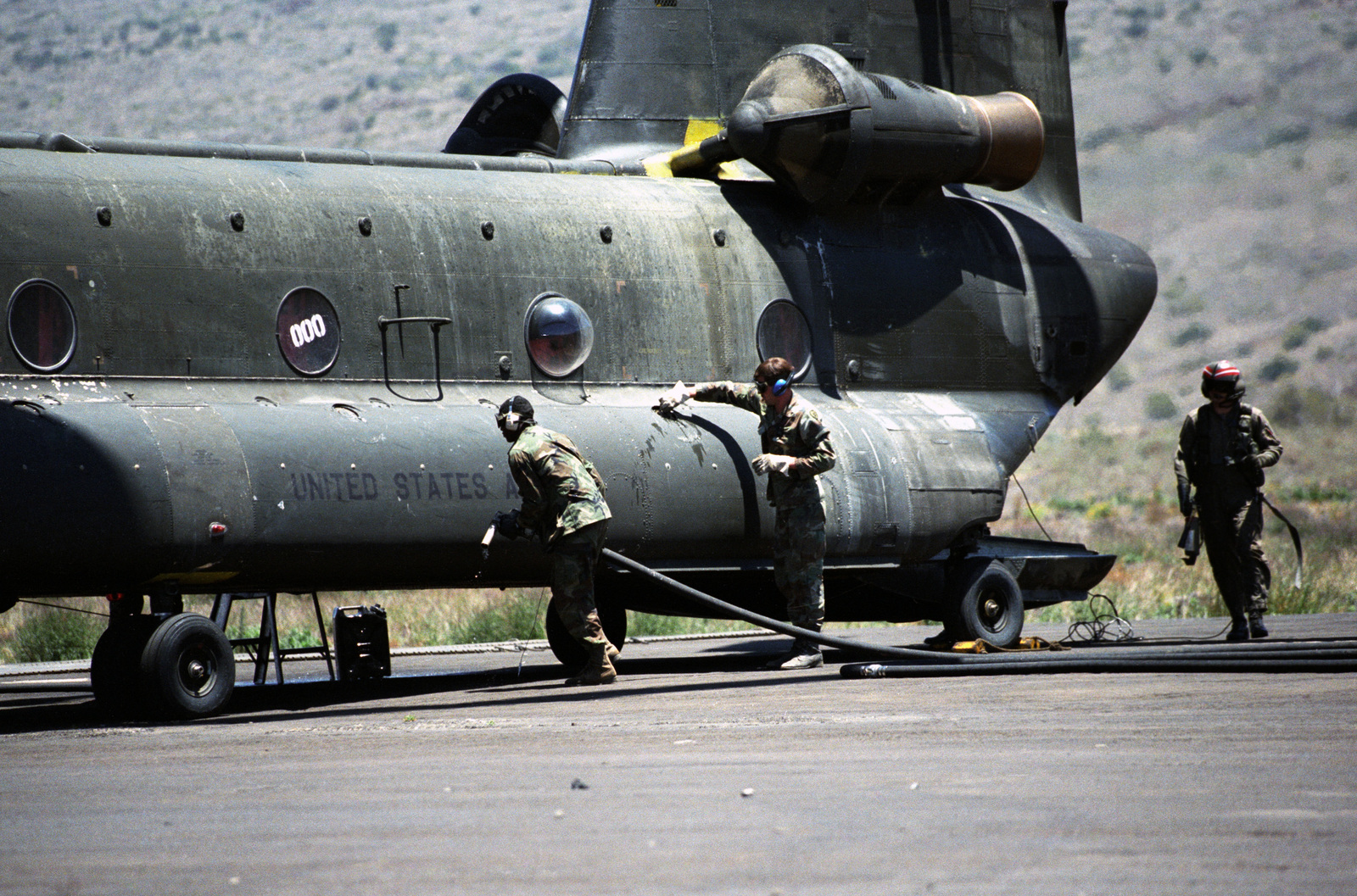 A CH-47 Chinook helicopter is refueled at Bradshaw Air Field during the 21st Infantry Division's annual Army training and evaluation program and field training exercise