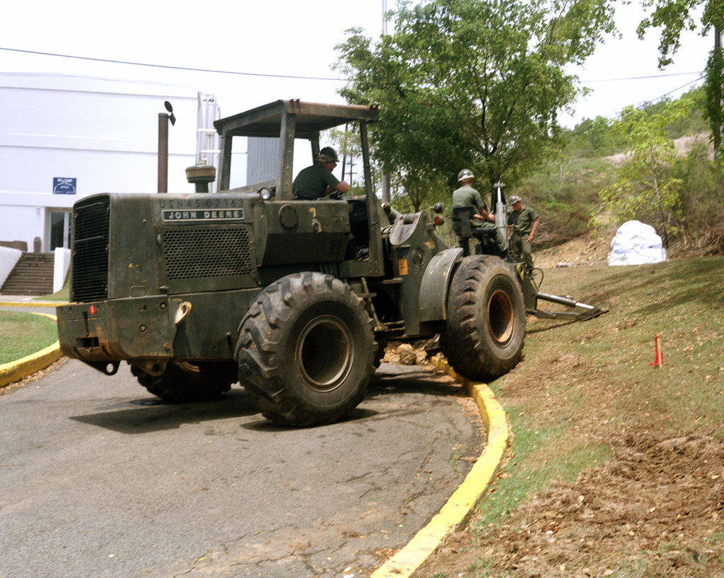 A member of Naval Mobile Construction Battalion 5 (NMCB 5) operates a front end loader