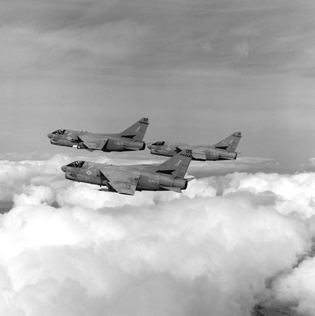 An air-to-air left side view of three Attack Squadron 72 (VA-72) A-7E Corsair II aircraft en route to a target range near Naval Air Station, Fallon, Nev., during Carrier Air Wing 7 (CVW-7) strike training
