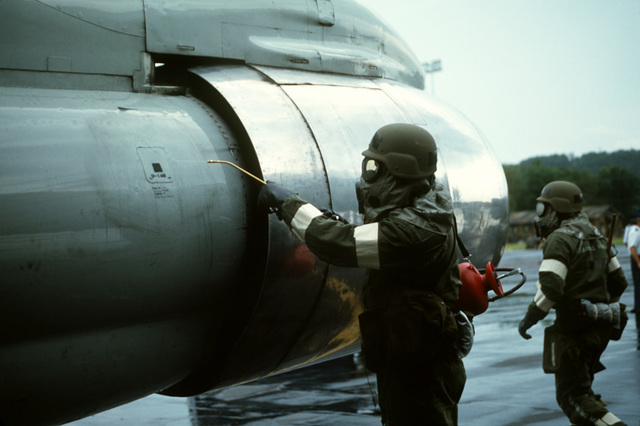 After a simulated chemical attack, members of the 171st Air Refueling Wing, Pennsylvania Air National Guard, decontaminate a KC-135E Stratotanker aircraft during Exercise Keystone Badger