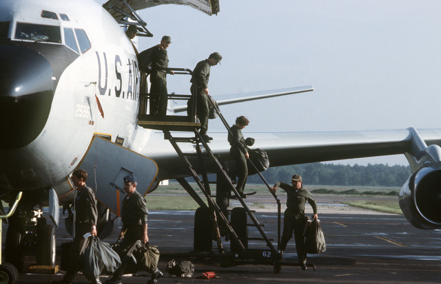 Members of the 171st Air Refueling Wing, Pennsylvania Air National Guard, exit their KC-135E Stratotanker aircraft upon arrival at Volk Field during Exercise KEYSTONE BADGER