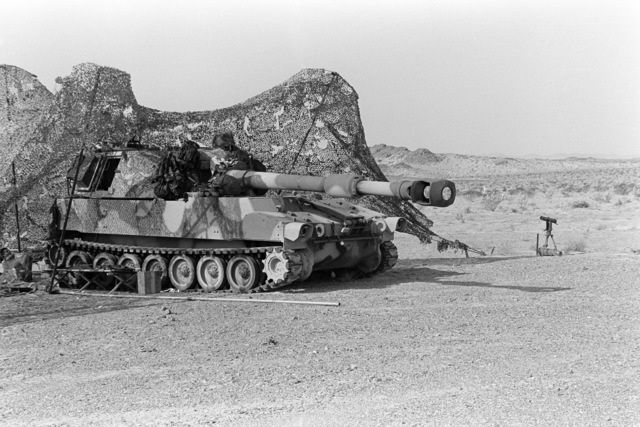 Camouflage netting covers an M109 self-propelled Howitzer during a training exercise