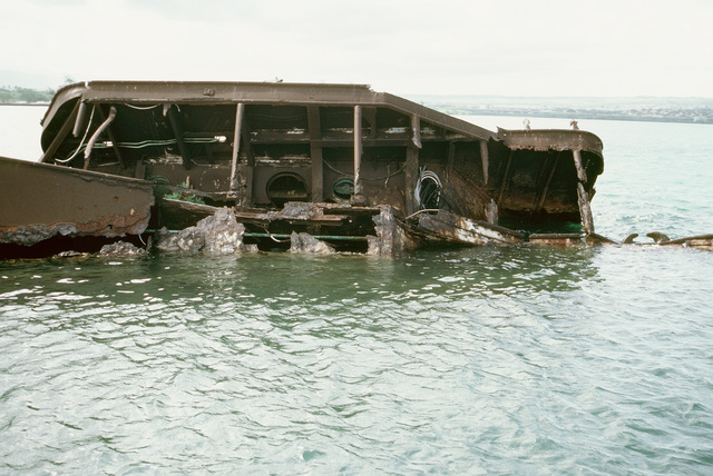 A view of the wreck of the former battleship-target ship USS UTAH (BB-31, AG-16), which was sunk at its moorings on the west side of Ford Island on December 7, 1941, during the Japanese attack on Pearl Harbor