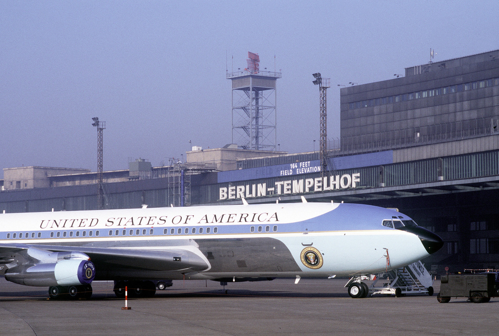 Air Force One, the VC-137C Stratoliner aircraft used to transport the president, sits in a roped-off area near the terminal building at Tempelhof Central Airport during President Reagan's visit to Berlin