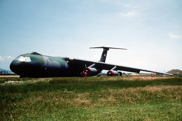 Ground level view of a 63rd Military Airlift Wing, Norton Air Force Base, California's C-141 Starlifter that was damaged when it ran off the end of the runway at Marine Corp Air Station Iwakuni, Japan. Both landing gears were torn off, the fuselage sustained heavy damage and fire destroyed half of the right wing. Exact Date Shot Unknown