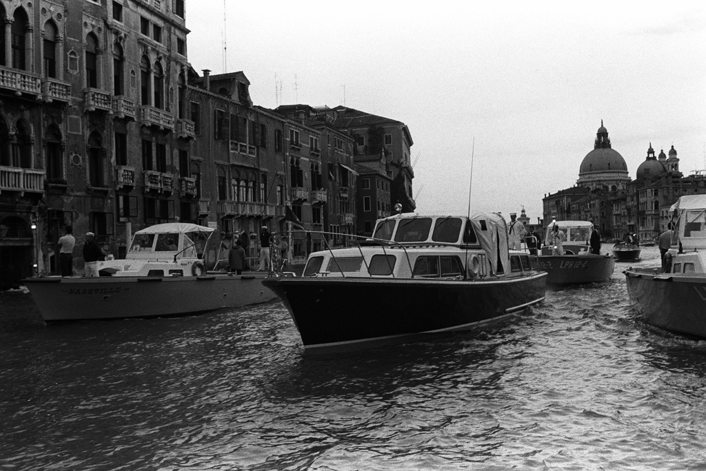 President Ronald Reagan's barge, flanked by security vessels, leads other boats in his party through the Grand Canal.  The barge is on loan from the commander of Carrier Group 8 while the president is attending the seven-nation economic summit.  Other boats in his party are from the amphibious transport dock USS NASHVILLE (LPD 13), the amphibious assault ship USS INCHON (LPH 12), the dock landing ship USS WHIDBEY ISLAND (LSD 41) and the commander, Fleet Air, Mediterranean