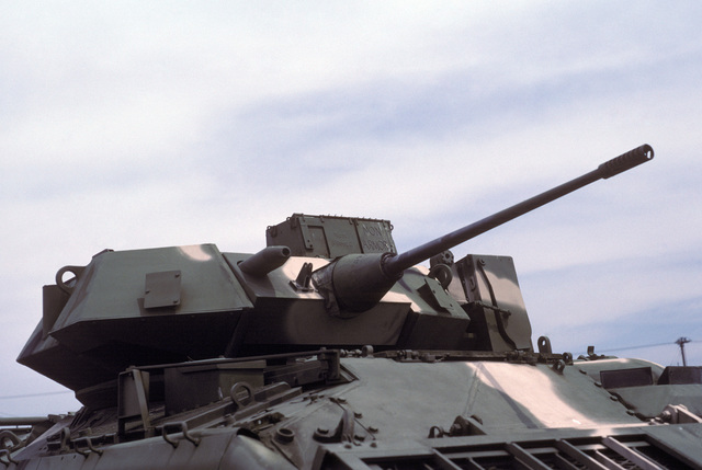 A close-up view of the 25 mm chain gun mounted on the top of a US Army M3 Bradley infantry fighting vehicle on display at the US Army Aberdeen Proving Grounds