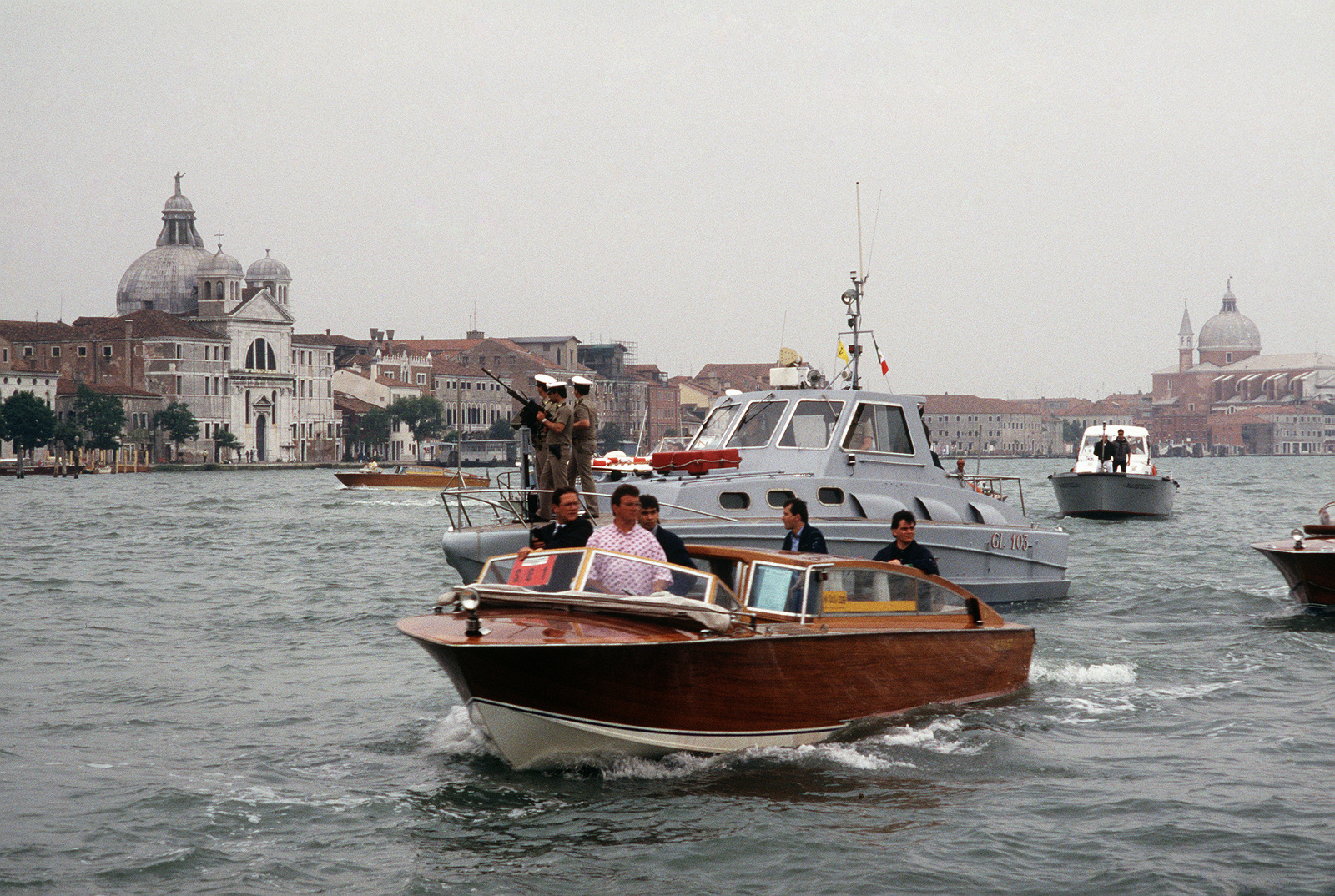 an italian water taxi and patrol boat provide security for president