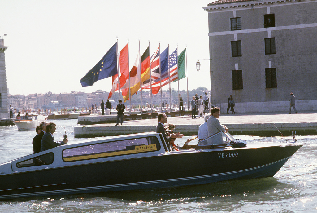 Security personnel use a water taxi to patrol the waters of the Grand Canal during President Ronald Reagan's visit to Venice for a seven-nation economic summit