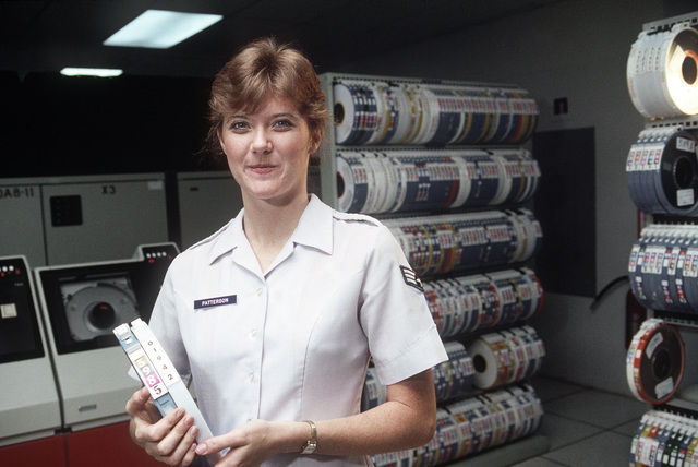 Sergeant (SGT) Nicola Patterson pauses while filing tapes in the 1913th Information Systems Group 1100/60 computer area