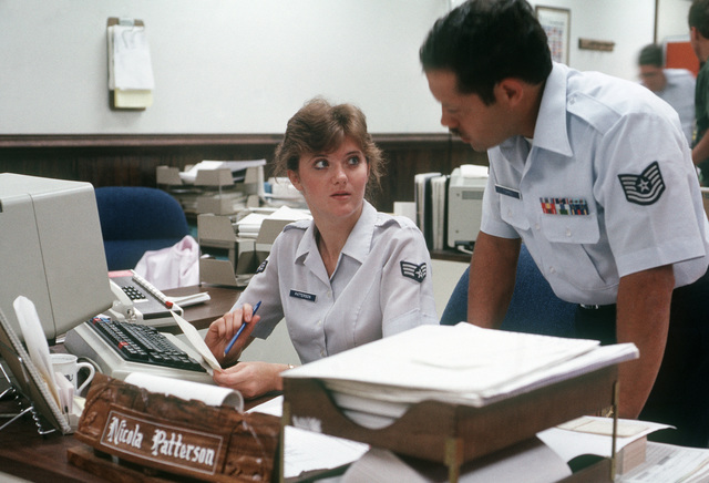 Technical Sergeant (TSGT) Robert Torres discusses operations with Sergeant (SGT) Nicola Patterson, another member of the 1913th Information Systems Group
