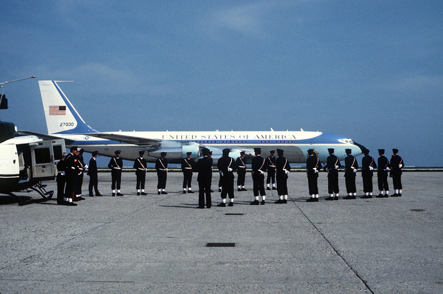 An Italian honor guard stands in formation on the tarmac at the Marco Polo Airport. Air Force One, A VC-137 Stratoliner aircraft, is standing by to fly President Ronald Reagan to Rome at the conclusion of the Venice Summit