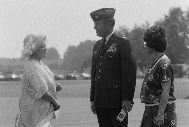 Colonel (COL) Clark, vice-commander, 435th Tactical Airlift Wing, and his wife, right, chat with Britain's Queen Mother.  The Queen Mother is heading back to Britain after visiting friends in the local Frankfurt area