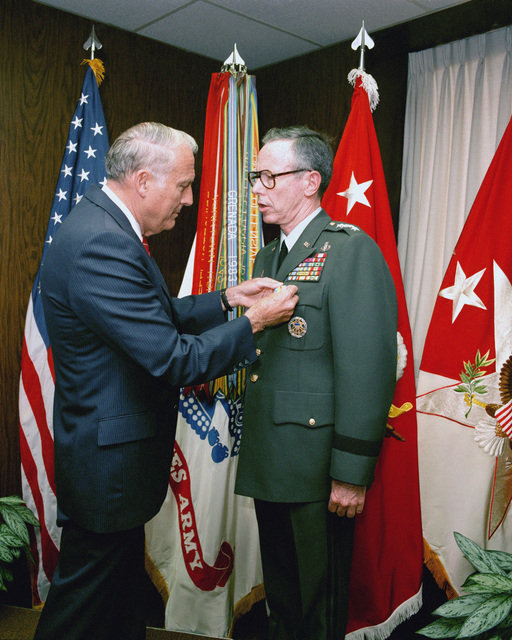 Secretary of the Army John O. Marsh Jr. presents the Distinguished Service Medal to General (GEN) Maxwell R. Thurman during a ceremony at the Pentagon. Thurman is leaving the office of vice chief of staff to become the commanding general of the Training and Doctrine Command