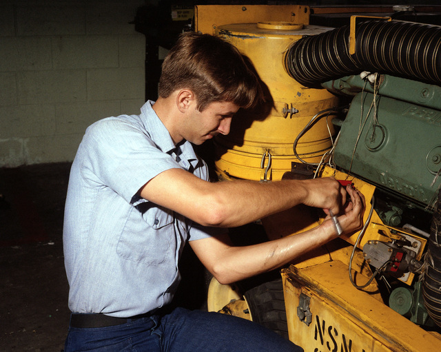 Aviation Support Equipment Technician (Electrical) 3rd Class Glen Reese adjusts the mechanical goveror of an NC-8A mobile powerplant at the Ground Support Equipment Facility, Aircraft Intermediate Maintenance Department