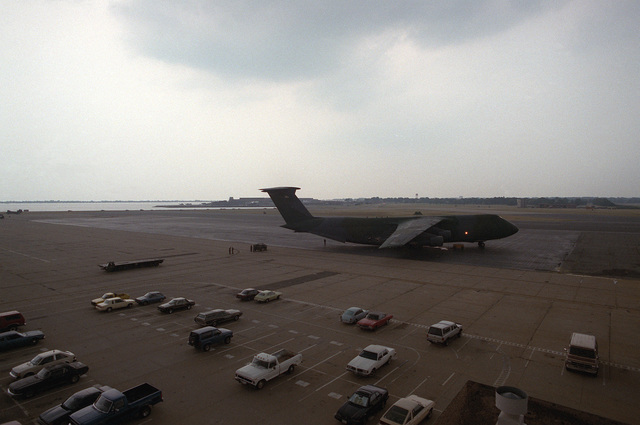 A C-5 Galaxy aircraft is positioned on the flightline in preparation for loading cargo and personnel of Helicopter Mine Countermeasures Squadron 14 (HM-14). The Squadron will be deployed to the Persian Gulf
