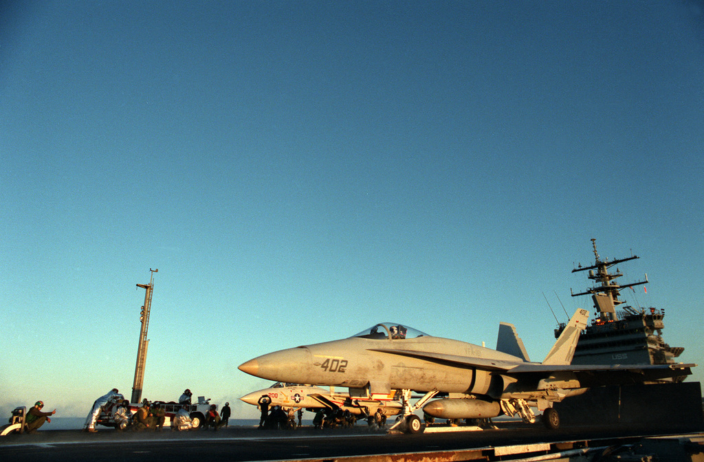 A Fighter-Attack Squadron 161 (VFA-161) F-18 Hornet aircraft is readied for launch on the flight deck of the nuclear-powered aircraft carrier USS ENTERPRISE (CVN-65). The carrier is en route to the Sea Fair Festival in Seattle