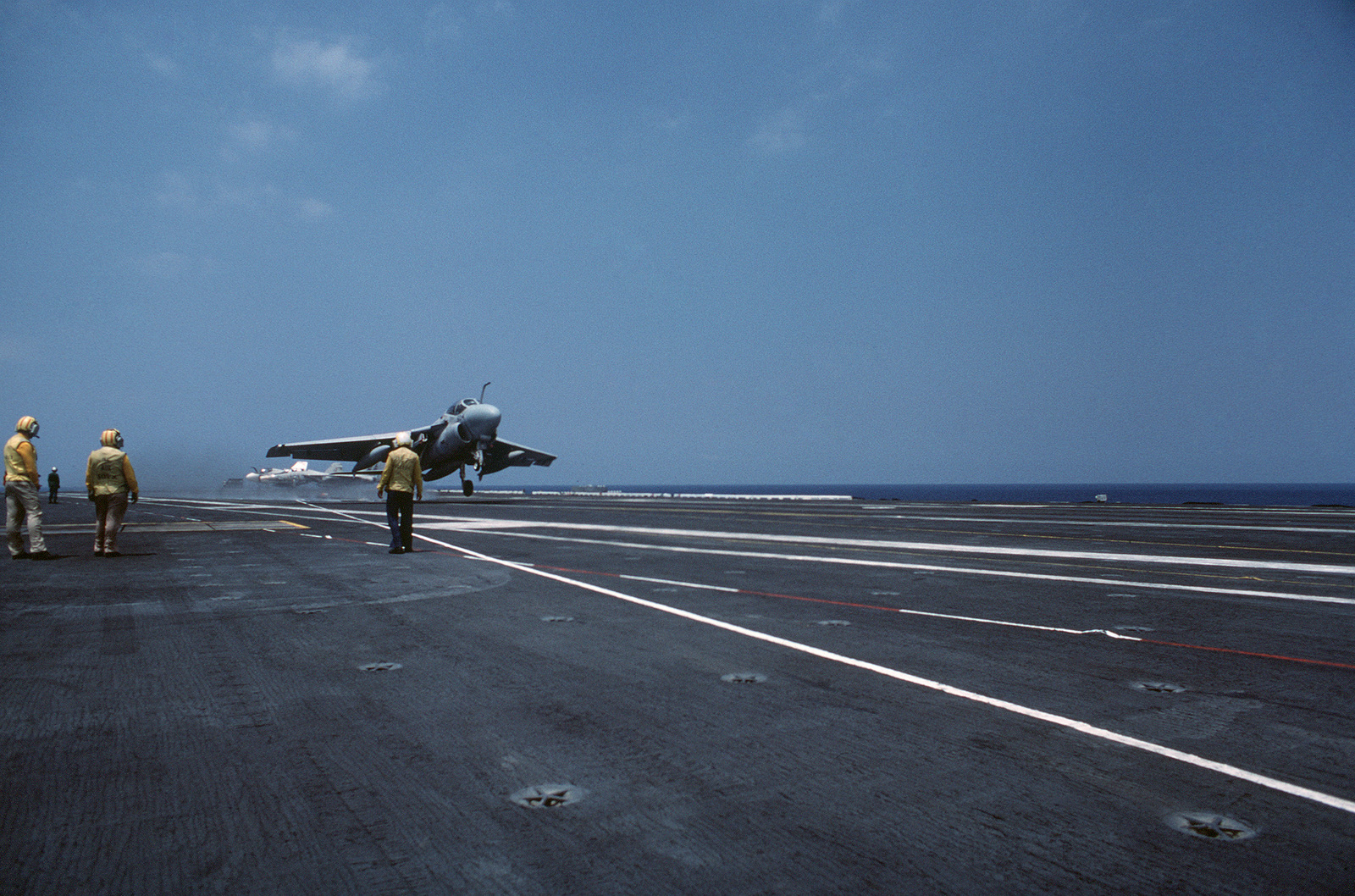 """An A-6E Intruder aircraft executes a""""touch and go""""landing during flight operations aboard the nuclear-powered aircraft carrier USS DWIGHT D. EISENHOWER (CVN 69).  Note:  First view in a series of three"""