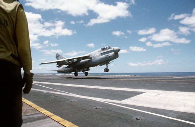 """An Attack Squadron 72 (VA-72) A-7E Corsair II aircraft executes a""""touch and go""""takeoff during flight operations aboard the nuclear-powered aircraft carrier USS DWIGHT D. EISENHOWER (CVN 69).  First view in a series of two"""