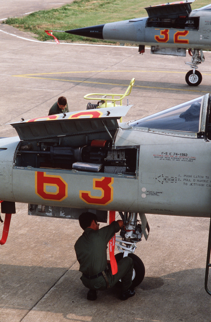 An F-5E Tiger II aircraft is readied for an upcoming mission during Exercise RED STAR'87.  The annual exercise, which is hosted by the 527th Aggressor Squadron, employs F-5 Tiger II aircraft and F-111 aircraft to simulate Soviet formations and tactics, thereby providing realistic training for US Air Force F-15 Eagle aircraft pilots