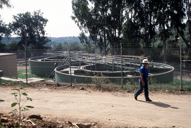 Antonio Armitrano, a local residents working as an inspector for the resident officer in charge of construction, looks over the air station's recently completed sewage treatment plant