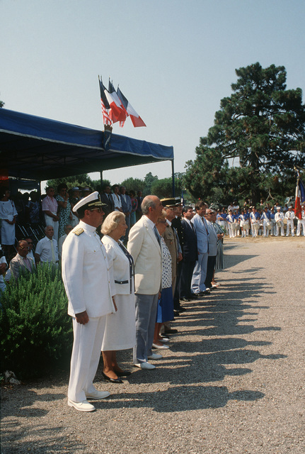 Vice Admiral (VADM) Kendall E. Moranville, commander, 6th Fleet, stands with French and American guests of honor at the Liberator Monument during the Festival American, a French and United Services Organization (USO) celebration of Independence Day.  The Liberator Monument marks the mountain crash site of a B-24 Liberator aircraft and honors the American pilot who died after diverting the severely damaged bomber from the city during World War II