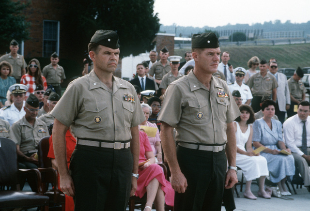 Lieutenant Colonels (LTC) Glynn, left, and Richard E. Peasley stand at attention during change of command and retirement ceremonies at Marine Helicopter Squadron 1 (HMX-1) headquarters.  Glynn is relieving Peasley as commanding officer of HMX-1 at Marine Corps Air Facility (MCAF), Quantico, Virginia (VA)