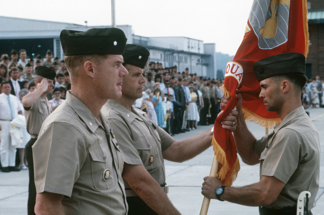 The colors are exchanged during the change of command ceremony of Marine Helicopter Squadron 1 (HMX-1).  Lieutenant Colonel (LTC) Richard E. Peasley, left is being relieved by Lieutenant Colonel (LTC) Glynn, right, the new commanding officer of the squadron at Marine Corps Air Facility (MCAF), Quantico, Virginia (VA)