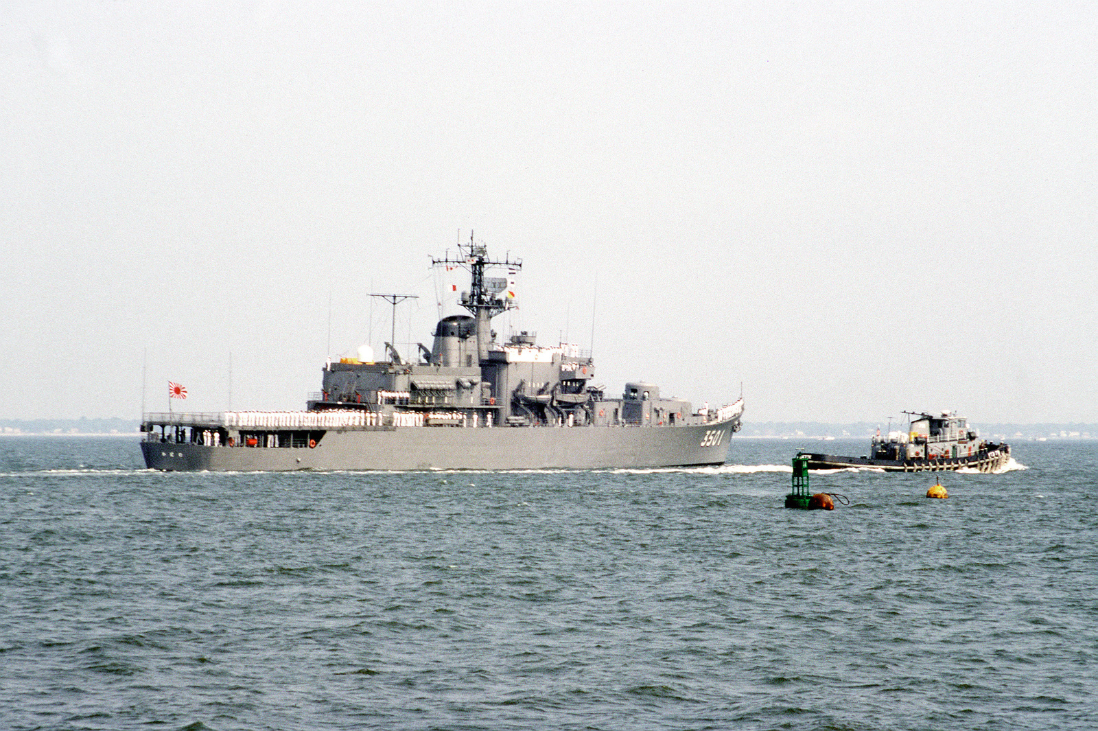 A starboard quarter view of the Japanese training ship KATORI (TV-3501) underway in the harbor. The KATORI, along with other ships from the Japanese Maritime Self-Defense Force, is visiting Naval Operating Base, Norfolk