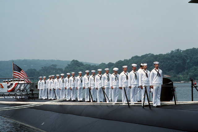 Side boys salute as Admiral (ADM) James B  Busey, vice chief