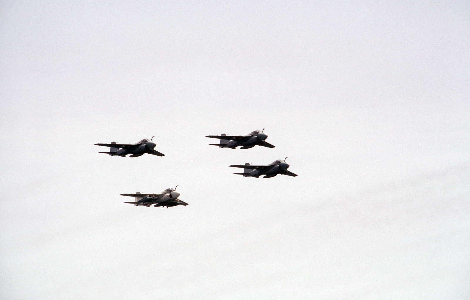 Three A-6E Intruder aircraft and a KA-6D Intruder fly in formation during an air show off the coast of Caracas, Venezuela.  The aircraft are assigned to the nuclear-powered aircraft carrier USS DWIGHT D. EISENHOWER (CVN 69)