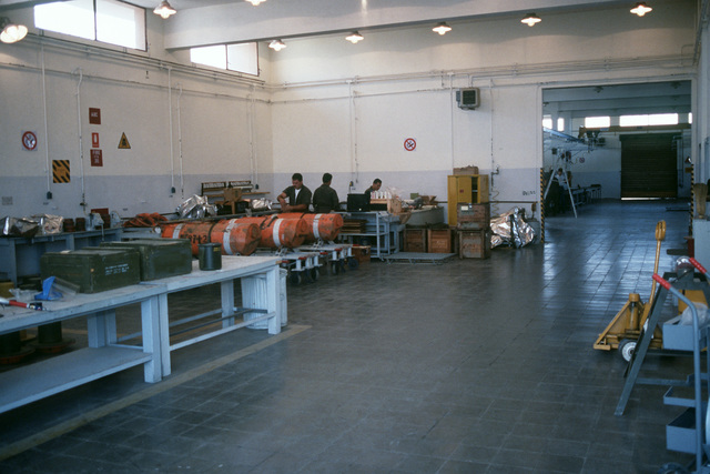 An interior view of the front half of the mine assembly building used by Mobile Mine Assembly Group Unit 5