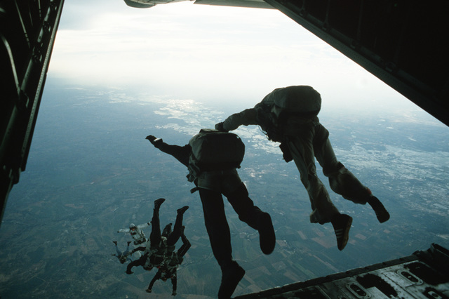 Thai, US Air Force and US Army paratroopers make a jump while participating in Exercise COBRA GOLD'87