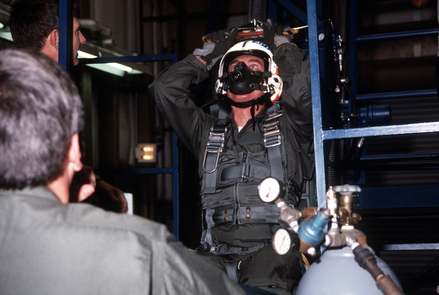 A student practices on the dynamic ejection seat trainer at the station's Aviation Physiology Training Unit