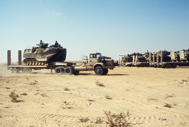 An Egyptian military tractor-trailer transports an AAVP-7A1 tracked assault amphibian vehicle during the multinational, joint service Exercise Bright Star '87
