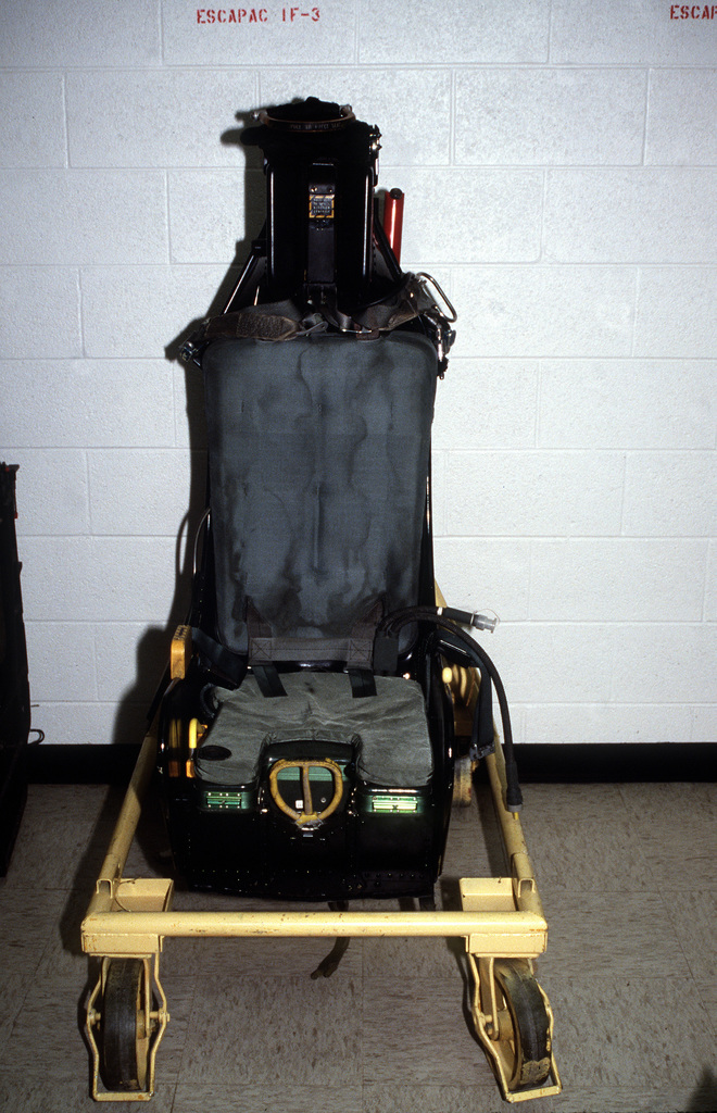 An Escapac IF-3 ejection seat is displayed at the station's Aviation Physiology Training Unit