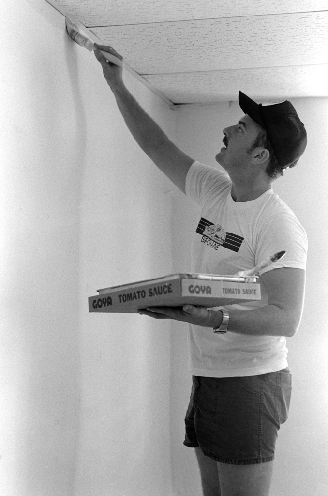 Constuction Electrician 1ST Class (CE1) James Monteressi, Naval Mobile Construction Battalion 133 (NMCB-133), paints the interior of the SENIOR Citizens Center while participating in a civic action project