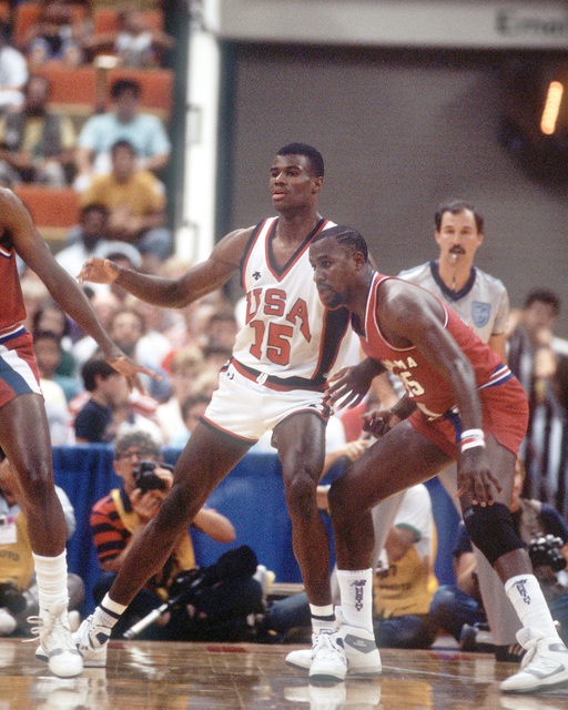 ENSIGN David Robinson tries to get open during a basketball game against the Panamanian team at the 10th Annual Pan American Games. Robinson and the rest of the U.S. men's basketball team would receive silver medals for their efforts in the games. Exact D