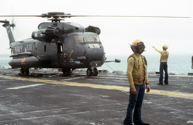 A CH-53E Sea Stallion helicopter prepares for lift-off from the deck of the amphibious assault ship USS GUADALCANAL (LPH 7). The ship is preparing to depart for the Persian Gulf