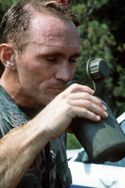 SENIOR AIRMAN (SRA) Younce takes a drink of water after competing in the weapons competition phase of DEFENDER CHALLENGE 87.  The competition offers security police squadrons from Military Airlift Command the opportunity to compete in areas that include w