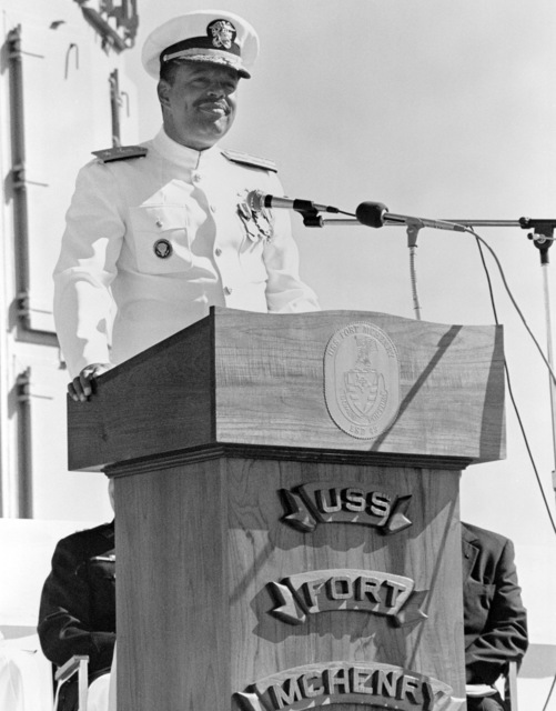 Rear Admiral (RDML) (lower half) Joseph P. Reason, commander, Naval Base, Seattle, speaks during the commissioning of the dock landing ship USS FORT MCHENRY (LSD 43)